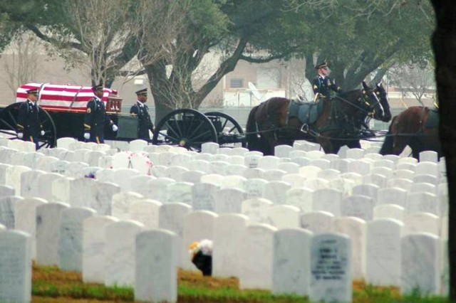 A funeral detail from the Headquarters and Headquarters Company U.S. Army Garrison takes a military member to their final resting place at the Fort Sam Houston National Cemetery.