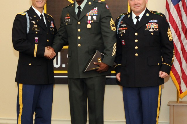 Master Sgt. Michael A. Williams, the host nations support noncommissioned officer for the 3d Sustainment Command (Expeditionary), is congratulated by Col. Christopher R. Toner, commander of the 3rd Brigade, 1st Infantry Division, Brigade Combat Team and his senior enlisted leader, Command Sgt. Maj. Drew E. Pumarejo, during the Fort Knox Retirement Ceremony here Friday, September 24 at the Leaders Club. Williams retired after 25 years of service and plans to re-enter the workforce immediately. During the ceremony, Williams was presented the Meritorious Service Medal for his service from September 30, 2000 to October 1, 2010. (U.S. Army photo by Sgt. Michael Behlin)
