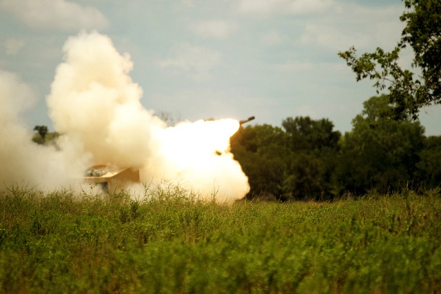 FORT HOOD, Texas - A multiple launch rocket system team from the 1st Battalion, 21st Field Artillery Regiment, fire rockets from a MLRS during a field exercise located at Fort Hood, Texas, July 19. The unit went out for a few days to train up new crews on the unit's equipment.