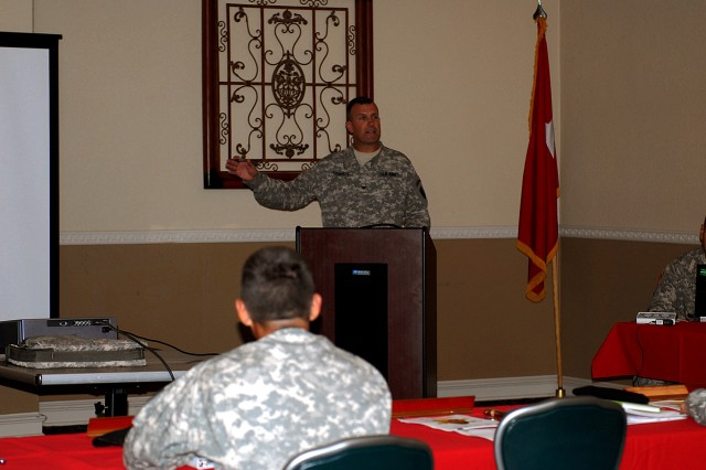 FORT HOOD, Texas - Col. John T. Thomson, brigade commander for the 41st Fires Brigade, 1st Cavalry Division, explains some of the expected changes to Fires Support and counterfire during the Fires Support conference at Club Hood, here, Sept. 2. The Redbook is a collection of standards for leaders to understand training requirements and was published Sept. 9