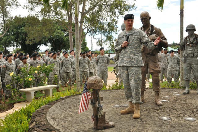 Maj. Gen. Bernard Champoux, commanding general, 25th Infantry Division, addresses the Soldiers, Noncommissioned officers and officers of Headquarters and Headquarters Battalion (HHBN) at the Tropic Lightning Memorial, outside of Fernandez Hall, Schofield Barracks, Hawaii, Oct. 1. Champoux thanked HHBN for their dedication and performance during the division's two-week mission readiness exercise in preparation for the upcoming deployment to Iraq. (U.S. Army photo by Sgt. Jesus J. Aranda, 25th Infantry Division Public Affairs Office)