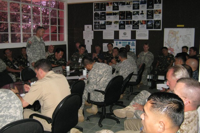 CAMP AQUINO, Philippines –Maj. Matthew Alden, U.S. Army, Pacific Contingency Command Post Intelligence Officer, briefs the Northern Luzon Command Command, Lt. Gen. Gaudencio S. Pangilinan Jr., during the Operational Planning Team Exercise held on Camp Aquino, Philippines.