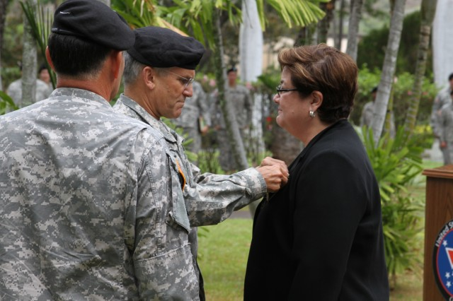 Army Chief of Staff Gen. George W. Casey Jr. pins the Superior Civilian Service Award on Civilian Human Resources Director Sandra Chun at a U. S. Army, Pacific awards ceremony at Fort Shafter, Hawaii Sept. 30. Casey spent the day with U.S. Army, Pacific Soldiers and Family members.