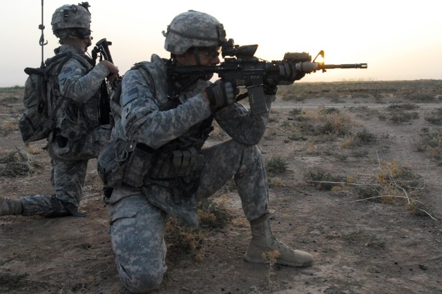 """1st Lt. Dan Chapman, a platoon leader with Headquarters and Headquarters Company, 1st Battalion, 14th Infantry, """"Golden Dragons"""" 2nd Advise and Assist Brigade, 25th Infantry Division out of Schofield Barracks, Hawaii, pulls security during a cordon and search, in the Rashaad Valley near Kirkuk, Iraq, Sept. 25.  The Iraqi Army led operation ended with the soldiers discovering a cache with more than 800 rounds of heavy machine gun ammo and detaining four suspects."""