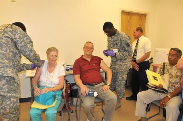 Attendees get immunizations during the Retiree Appreciation Day event at Fort Lee.
