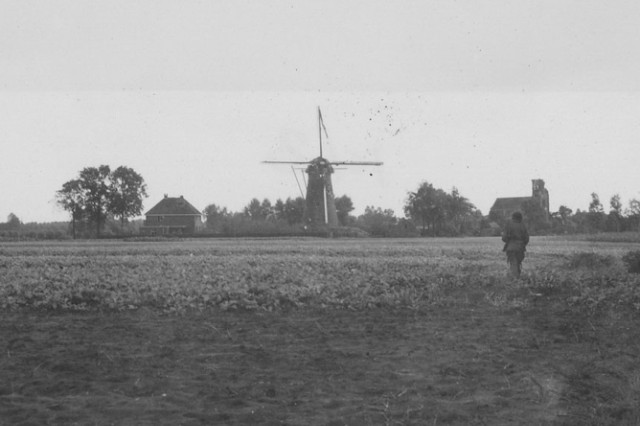A U. S. Army Paratrooper from the 101st Airborne (Screaming Eagles), on patrol near a windmill on the Island, Heteren, Holland, in October 1944 during Operation Market-Garden. (S. L. A. Marshall Collection)