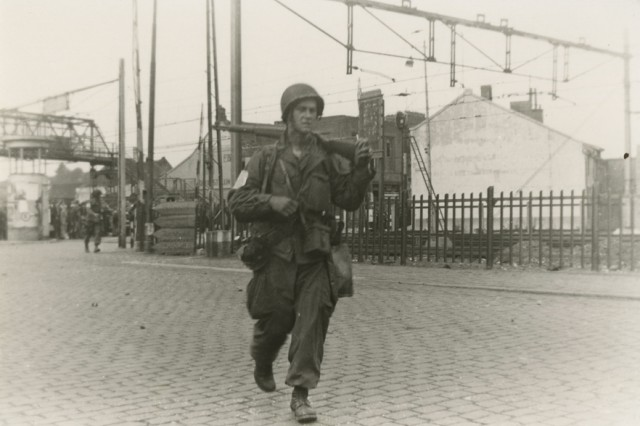 A paratrooper with the 101st Airborne Division (Screaming Eagles) patrols a street in Holland in September 1944 during Operation Market-Garden.  (George Koskimaki Collection)