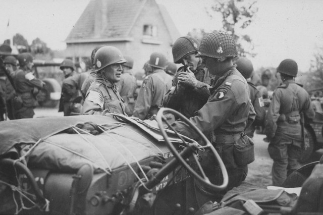 Commanders of the 101st Airborne Division (Screaming Eagles), meet near Zon, Holland during Operation Market-Garden on September 17, 1944.  From left to right:  Brigadier General Anthony McAuliffe, Division Artillery Commander; Colonel Robert Sink, 506th Parachute Infantry Regiment Commander; and Colonel Joseph Harper, 327th Glider Infantry Regiment Commander. (S. L. A. Marshall Collection)