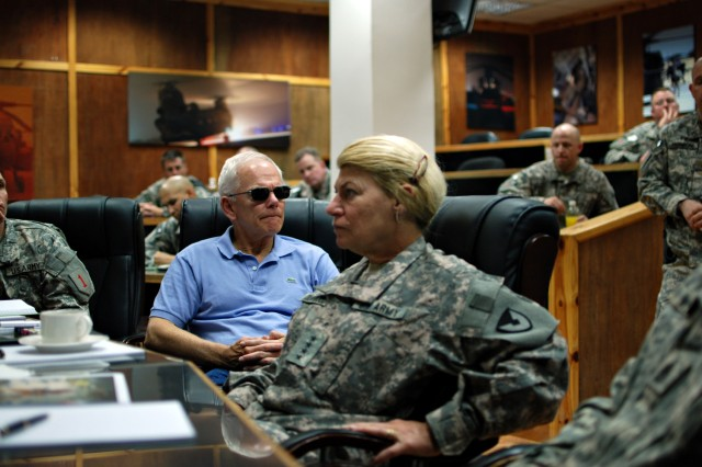 Gen. Ann E. Dunwoody, center, and Malcolm Ross OAca,!a,,cNeill, assistant secretary of the Army (Acquisition, Logistics, and Technology), attend a briefing with the Enhanced Combat Aviation Brigade, 1st Infantry Division, Sept. 26 on Camp Taji, Iraq.