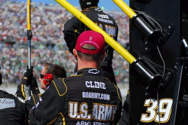 A member of the number 39 U.S. Army racing team wears a 'Big Red One' hat, Oct. 3 during the Price Chopper 400 race at the Kansas Speedway.
