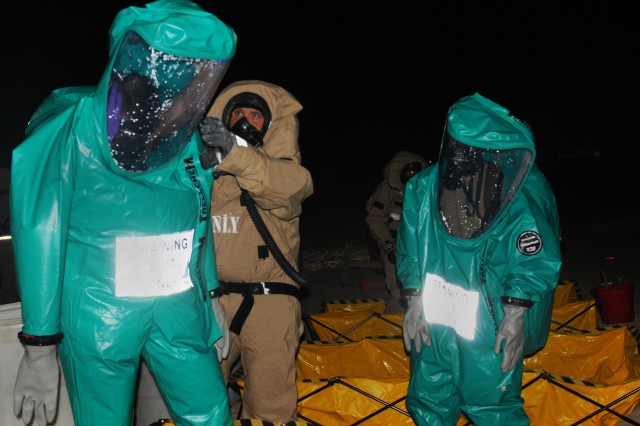 Alabama National Guardsmen of the 1343rd Chemical Company, 151st CBRNE, 115th Fires Brigade and Marines from the 22nd Marine Expeditionary Unit are decontaminated during joint training at Camp Buehring, Kuwait, Sept. 3.
