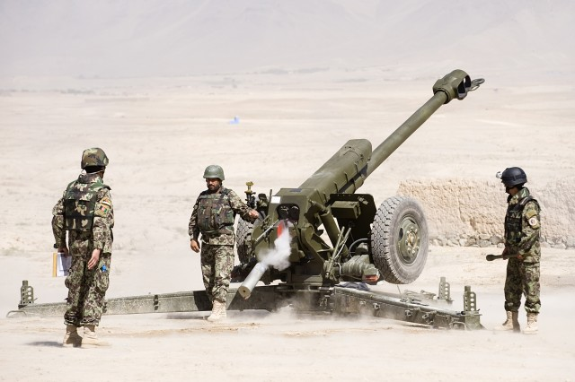 Afghan National Army instructors fire artillery from the 122 milimeter howitzer D-30 Oct. 4, 2010.  This demonstation marked the end of the train the trainer course and the opening ceremony for the artillery school where these instructors will teach.