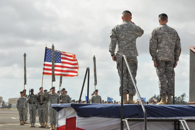Col. Mike D. Lundy, commander, 25th Combat Aviation Brigade (left), salutes the brigade's Color Guard, alongside Maj. Gen. Bernard S. Champoux, commanding general, 25th Infantry Division, during a redeployment ceremony honoring the brigade's return to Hawaii following a 12-month deployment to northern Iraq, at Wheeler Army Airfield, Hawaii, Oct. 05. During the ceremony, friends, family and guests witnessed the squadron and battalions of the 25th CAB uncase their respective colors, officially returning to service on Hawaii. (U.S. Army photo by Sgt. Jesus J. Aranda, 25th Infantry Division Public Affairs Office)