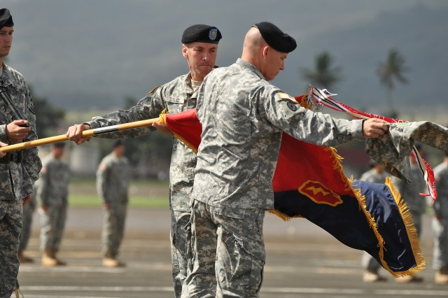 Col. Mike D. Lundy, commander, 25th Combat Aviation Brigade (CAB), uncases the  brigade colors with Command Sgt. Maj. Jess Ruiz, command sergeant major, 25th CAB (left), during a redeployment ceremony honoring the brigade's return to Hawaii following a 12-month deployment to northern Iraq, at Wheeler Army Airfield, Hawaii, Oct. 05. During the ceremony, friends, family and guests witnessed the squadron and battalions of the 25th CAB uncase their respective colors, officially returning to service on Hawaii. (U.S. Army photo by Sgt. Jesus J. Aranda, 25th Infantry Division Public Affairs Office)