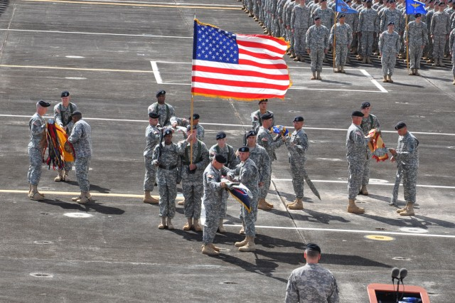 Col Mike D. Lundy, commander, 25th Combat Aviation Brigade, leads his battalion commanders  during a simultaneous uncasing of the brigade and unit colors as a symbol of 25th CAB's return home from a 12-month deployment to northern Iraq , during the 25th Combat Aviation Brigade redeployment ceremony at Wheeler Army Air Field, Hawaii, Oct. 05. (U.S. Army photo by Spc. Mahlet S. Tesfaye, 25th Infantry Division Public Affairs Office)