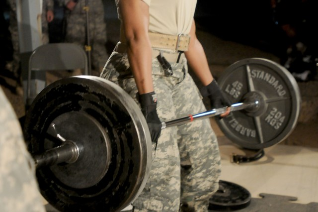 Sgt. 1st Class Cleopatra Griggs-Adams, a network engineer with 3rd Signal Company, Division Special Troops Battalion, 3rd Infantry Division, participates in the dead-lift event during the Rocky Elite Iron Warrior Competition, Oct. 2, at Contingency Operating Base Speicher, near Tikrit, Iraq. The competition tested the endurance of both males and females in a three-series weight lifting event which included the squat, the bench press and the dead-lift. Sergeant First Class Griggs-Adams won first place in the woman's part of the competition, earning 665 total pounds lifted.