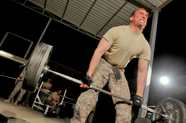 Sgt. 1st Class Rob Nicholson, the G-9 noncommissioned officer in charge, Headquarters Headquarters Operations Company, Division Special Troops Battalion, 3rd Infantry Division, participates in the dead-lift event during the Rocky Elite Iron Warrior Competition, Oct. 2, at Contingency Operating Base Speicher, near Tikrit, Iraq. The competition tested the endurance of both males and females in a three-series weight lifting event which included the squat, the bench press and the dead-lift.