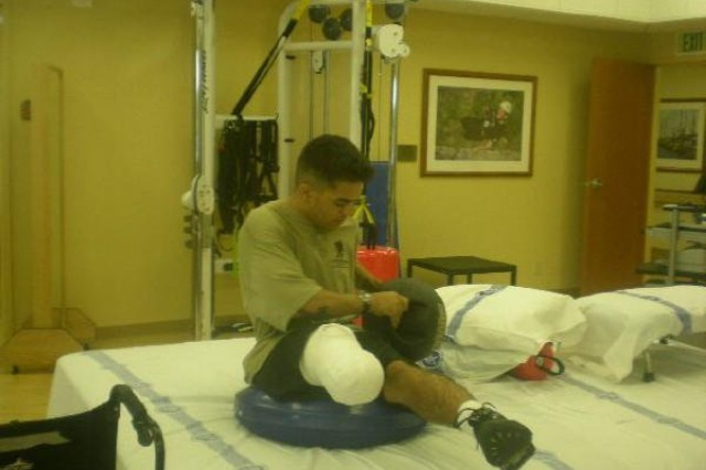 Sgt. Robert Barthel exercises with a medicine ball  at Naval Medical Center in San Diego.
