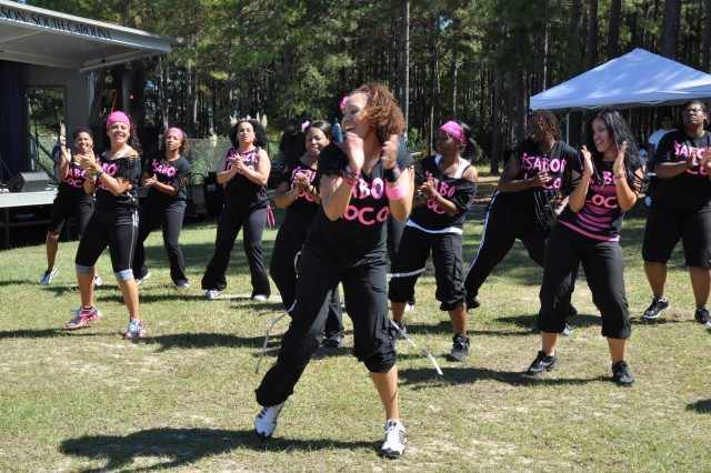 Carmen Thomas, front, fitness instructor, and her class perform a Zumba routine. Zumba is a fitness program that combines aerobics and Latin dance.