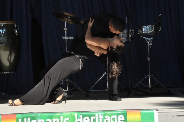 Salsa dancers Blanca and Chris Flores, of the Con Sabor Dance Company, perform during Fort Jackson's Hispanic Heritage celebration. The event was hosted by the Soldier Support Institute and featured food, music and informational displays.