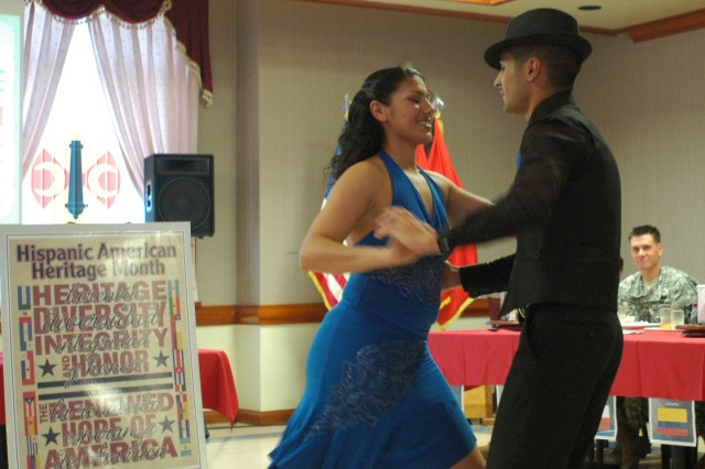 CAMP CASEY, Republic of Korea – Sgt. Ione Barrera of A Company, Division Special Troops Battalion (left) and Sgt. Josue Ten of B Company, DSTB, dance Salsa during the 2nd Infantry Division Hispanic heritage month celebration at the Camp Casey Thunder Inn dining facility Oct. 6. The two 2nd ID Soldiers and guest speaker Sgt. Alejandro Morlote of A Battery, 1st Battalion, 38th Field Artillery Regiment, 210th Fires Brigade received a plaque from 2nd ID commander Maj. Gen. Michael S. Tucker.