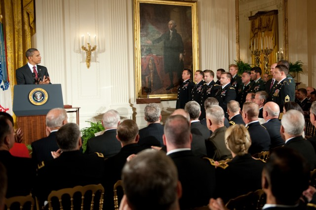 President Barack Obama thanks U.S. Army Green Beret members who were in the same unit as Medal of Honor recipient Staff Sgt. Robert J. Miller at the ceremony for Miller in the East Room of the White House in Washington, D.C., Oct. 6, 2010.  Miller was posthumously awarded the honor for his heroic actions in Afghanistan, displaying immeasurable courage and uncommon valor eventually sacrificing his own life to save the lives of his teammates and 15 Afghanistan National Army soldiers.