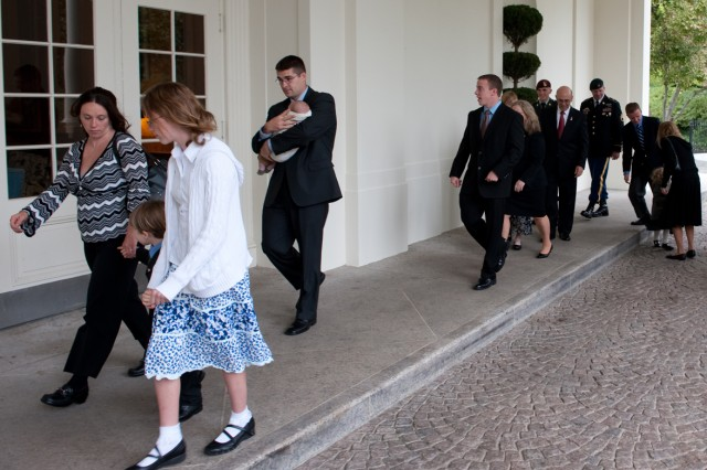 The family of Staff Sgt. Robert J. Miller arrive at the White House in Washington, D.C., to attend the Medal of Honor ceremony that is being posthumously awarded to Miller on Oct. 6, 2010.