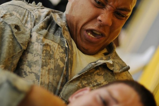 Capt. Jason Norwood, officer in charge of the Fort Sill Combatives School, puts David Stefl in a choke hold during a match Oct. 1 at the 2010 U.S. Army Championship Combatives Tournament at Fort Benning, Ga. Norwood went on to win the cruiserweight division.