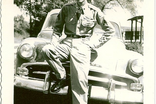 Then 17 years old, Pvt. David Mills  poses in front of his father's 1952 Plymouth just after he arrived home from Korea in September 1953.