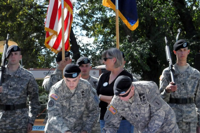 """Col. Paul Calvert, commander of the 2nd HBCT, 1st Inf. Div., left, and Command Sgt. Maj. Rodney R. Lewis, senior enlisted adviser with the 2nd HBCT, sign the Army Community Covenant Oct. 2 in Abilene. The covenant reaffirms the """"Dagger"""" Brigade's mutual commitment with the county."""