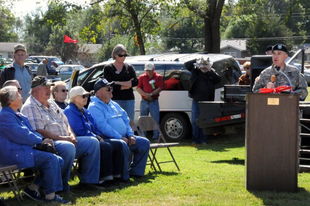 """Col. Paul Calvert, commander of the 2nd HBCT, 1st Inf. Div., far right, speaks to Dickinson County residents during the resigning of the Army Community Covenant between Dickinson County and Fort Riley, Kan., Oct. 2 in Abilene, Kan. The covenant reaffirms the """"Dagger"""" Brigade's mutual commitment with the county."""