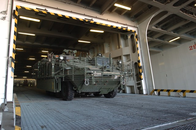 A Stryker returning from Iraq is driven down the interior ramp of the ARC Endurance, a U.S.-flagged commercial roll-on/roll-off vessel during offload operations at Port Canaveral, Fla., Oct. 6.