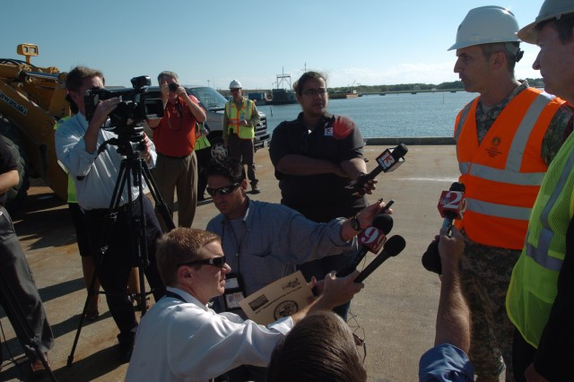 Lt. Col. Bleu Hilburn, commander, 832nd Transportation Battalion, talks with local media at Port Canaveral, Fla. The offload of 4/2 Stryker Brigade's equipment generated interest at a location normally known for cruise ships and space shuttles.