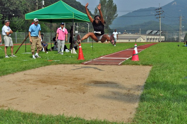 Aundi Lynch, Headquarters and Headquarters Battery, 1st Heavy Brigade Combat Team, Camp Hovey, completes a long jump of 13 feet, 4 inches, for first place in the event.