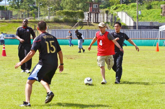 Soldiers from the 304th Signal Battalion battle for ball during a pickup soccer game.