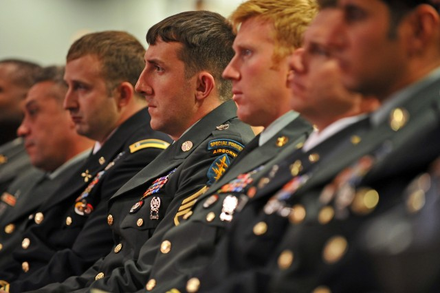 Staff Sgt. Robert J. Miller's Special Forces teammates listen to the Medal of Honor citation of their comrade. Miller was killed Jan. 25, 2008 in Afghanistan while single-handedly holding off Taliban insurgents. At the expense of his life, Miller's actions allowed his team and 15 Afghan soldiers to fall back from a close-range ambush.