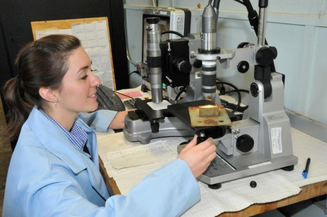 Michelle Shutz, a materials engineer with ARDEC's Advanced Materials and Device Prototyping Lab, looks at a corrosion test panel under a digital microscope to study how certain paints withstand various weather conditions.