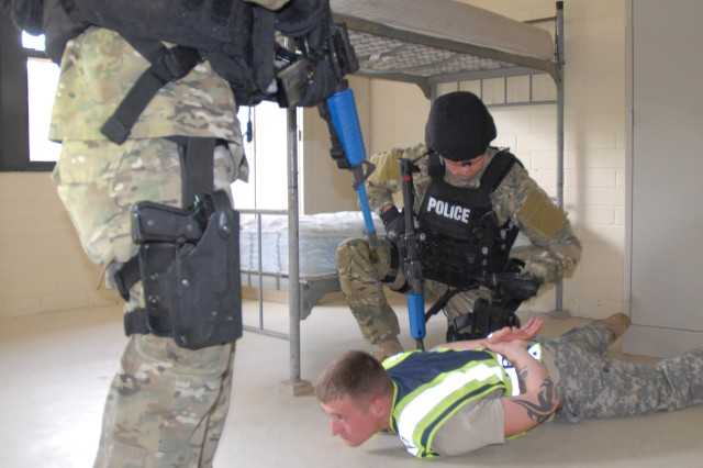 """Fort Jackson police officers apprehend a """"suspect"""" during a training exercise that mimicked the mass shooting at Fort Hood, Texas, last year."""