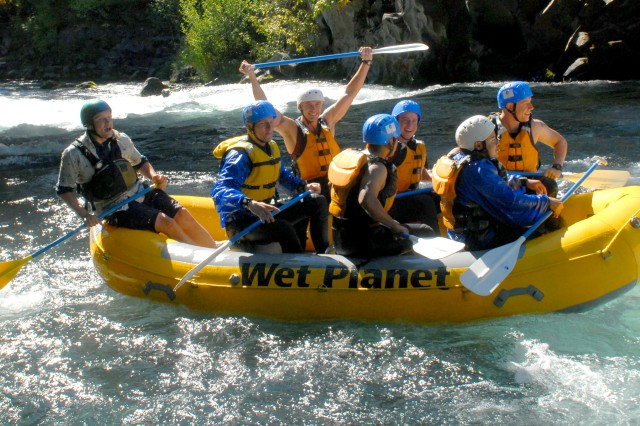 Soldiers celebrated after going through a stretch of rapids on the Hood River.