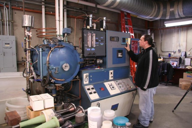 Dave Dekmar programs a vacuum furnace in the Particulate Materials Lab.
