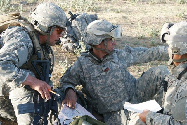 """NORTHERN AFGHANISTAN  -   Col. Edward B. Daly, deputy commanding officer of USARAK provides direction during a combat air assault in northern Afghanistan. (Courtesy photo)"""""""