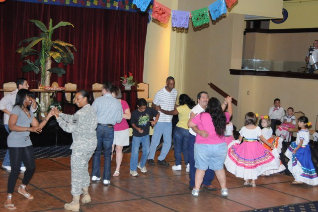 Soldiers and civilians dance the night away during the first Hispanic Dance Night at The Landing Sept. 30. The event is part of Hispanic Heritage month celebrated now until Oct. 15.