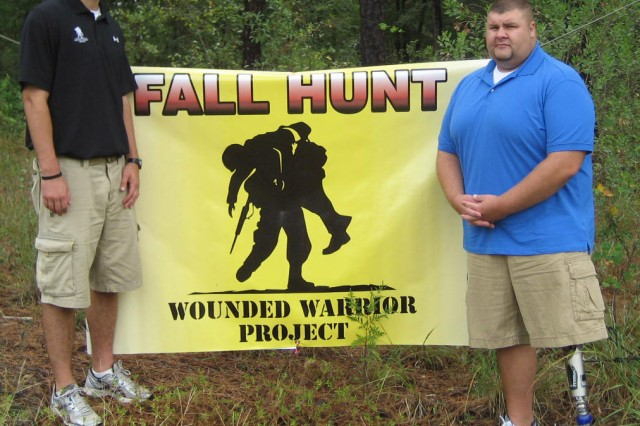 Second Lt. Chris Curran, B Co., 1st Bn., 145th Avn. Regt., and wounded warrior Lance Gieselmann set up Wounded Warrior Project displays in Dothan Sept. 27. Gieselmann lost his left leg and sustained other injuries in an IED explosion while serving in Iraq in 2003. He is one of several injured servicemembers participating in the annual WWP hunt this year, which runs from Oct. 23-30 on post and in the surrounding communities.