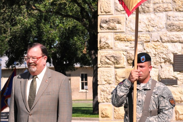 Frank E. Blakely II, manager, Army Support Activity stands at attention during a ceremony at the Fort Sam Houston Quadrangle Sept. 30.