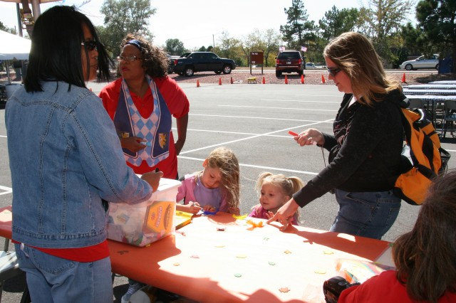 FORT CARSON, Colo.- Family members participate in crafts activities at the Oktoberfest event Saturday at The Hub.