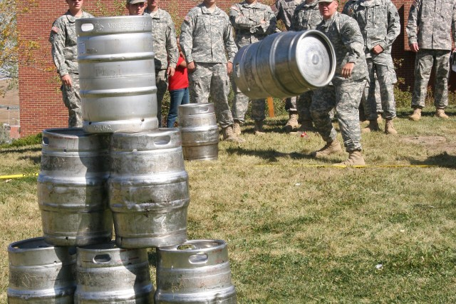 FORT CARSON, Colo.- Spc. Daniel Adkins waits to see how many kegs he'll knock down in the keg bowling event Saturday at The Hub.