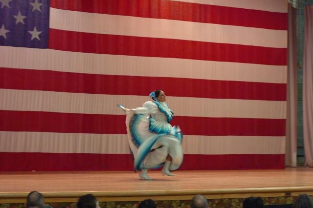 FORT BLISS, Texas (Oct. 7, 2010) Karen Ramos of Ballet de Folklorico of El Paso dances the El son de la negra dance as part of the folklorico dance presentation during the Hispanic American Heritage Month observance held at Soldier Hall here Oct. 7.
