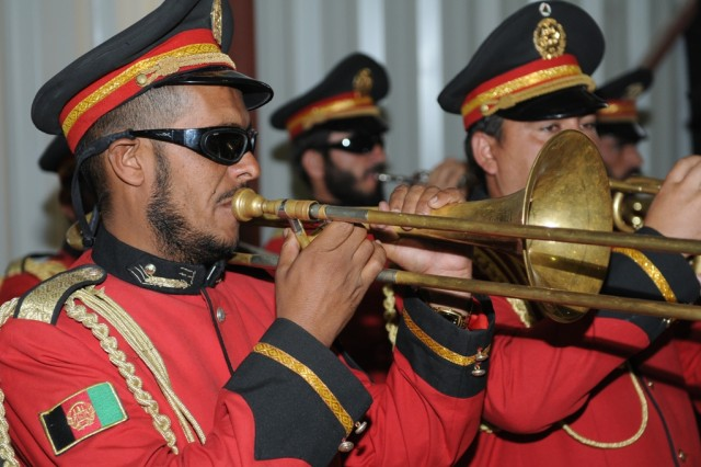 An Afghan military band member plays the Afghan national anthem during a ceremony celebrating the first year of the Afghan Kandahar Air Wing at Kandahar Airfield, Afghanistan, Oct. 5.