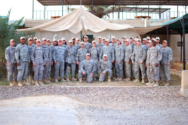 Senior leaders from deployed Army aviation units pose for a photo on Camp Taji, Iraq, Oct. 7. The aviators, all part of the Enhanced Combat Aviation Brigade, 1st Infantry Division, held a conference to discuss their current and future operations in Iraq. The eCAB, 1st Inf. Div. is the Army's first enhanced brigade and the Army's sole aviation asset supporting Operation New Dawn. (U.S. Army photo by Spc. Roland Hale, CAB, 1st Inf. Div. PAO)