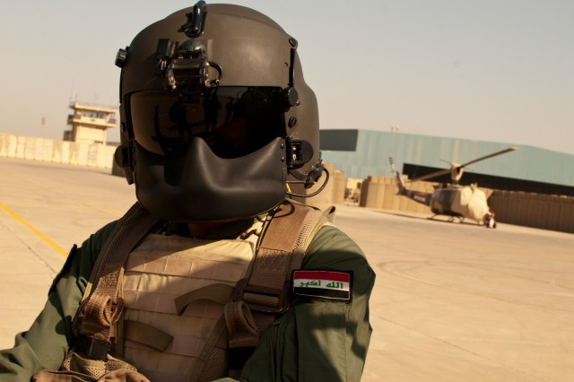 An Iraqi army helicopter crew-chief stands on Camp Taji, Iraq, Oct. 10. The crew-chief participated in a joint flight between the Enhanced Combat Aviation Brigade, 1st Infantry Division and the 2nd Squadron, Taji Wing. (U.S. Army photo by Spc. Roland Hale, eCAB, 1st Inf. Div. PAO)